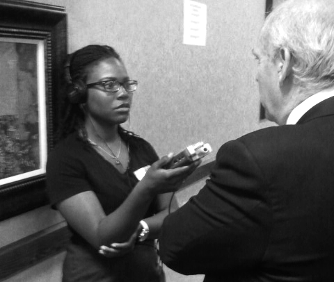 Generation Justice Alumna Jonquilyn Hill conducts an audio interview at the NM KIDS COUNT Conference. Jonquilyn is a recent  graduate of Howard University with a degree in Broadcast Journalism.